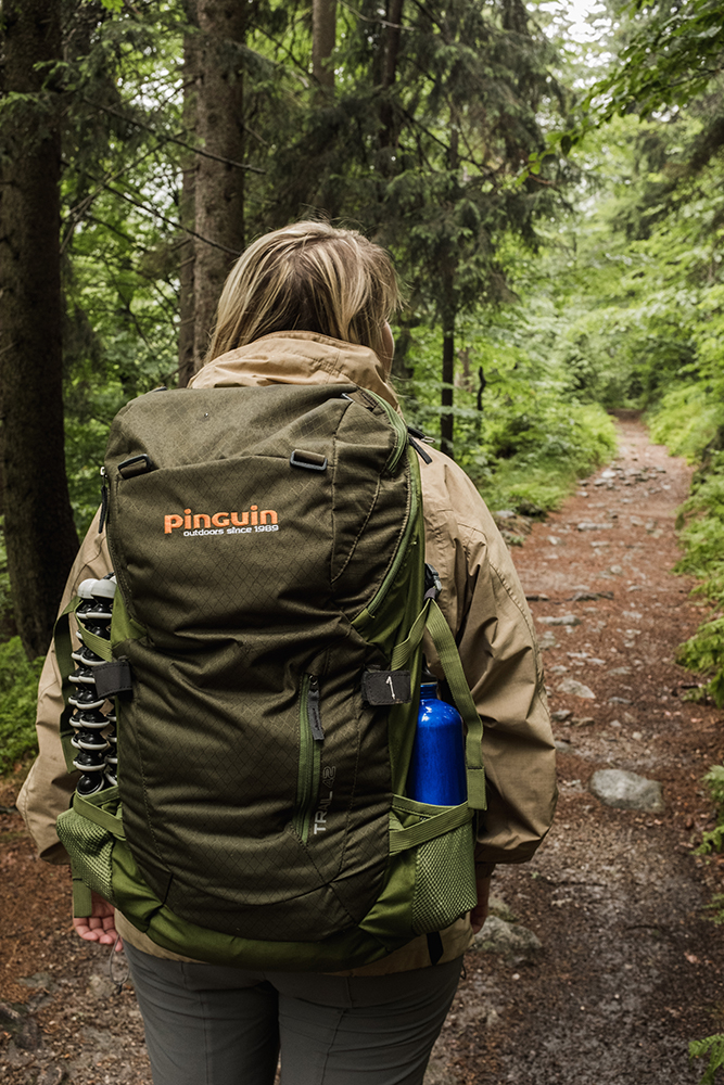 A girl wearing the Trail 42 backpack