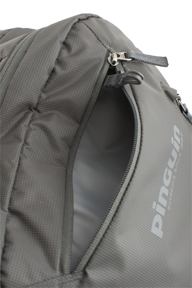 Integral 30 - Zipped pocket with keychain carabiner on the top of the backpack.