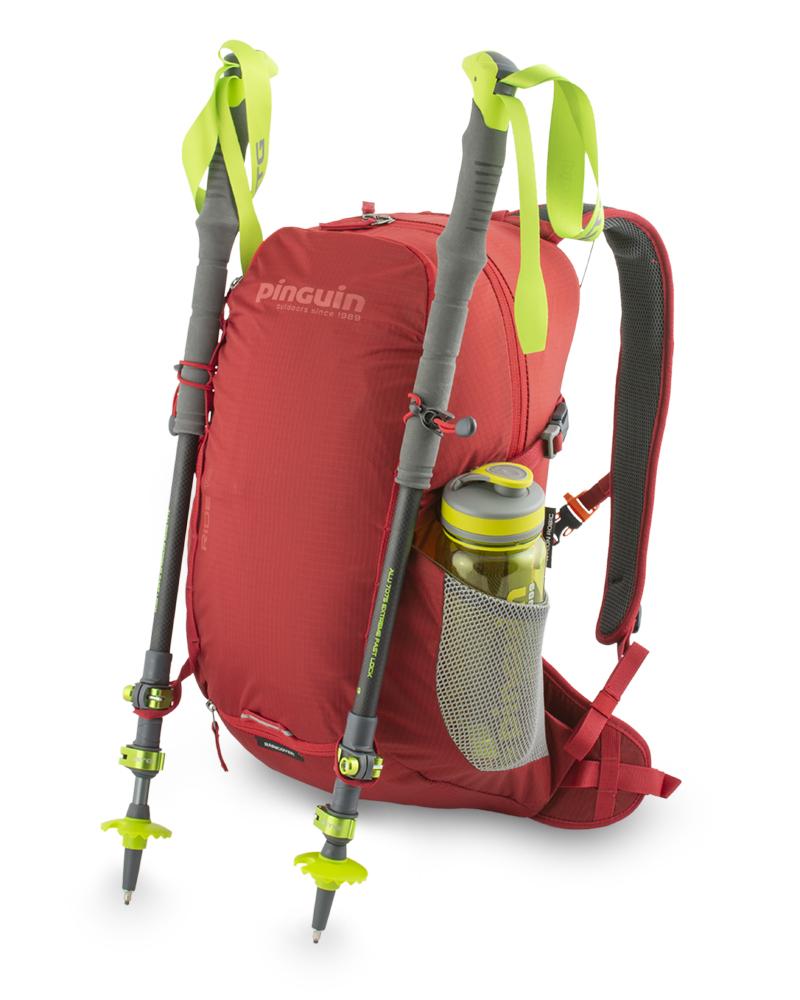 Ride 19 red - pružná poutka s háčky na připevnění teleskopických holí a poutka na dně batohu. Boční síťované kapsy na lahve.